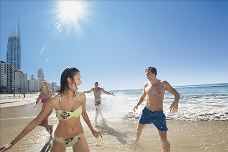 Tourists play on one of the Gold Coast's many beaches.