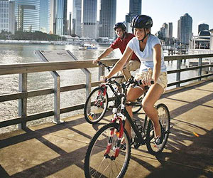 Cycling along the Brisbane River.