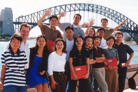 International students in front of Sydney Harbour Bridge.